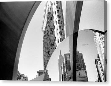 Canvas Print featuring the photograph Flat Iron Building Empire State Mirror by Dave Beckerman