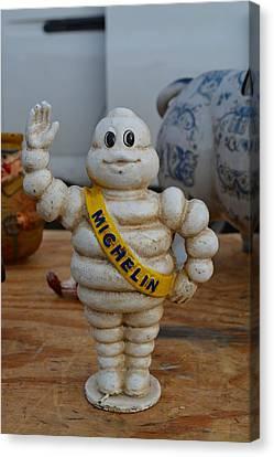 Flea Market Michelin Man Canvas Print by Helene Dignard