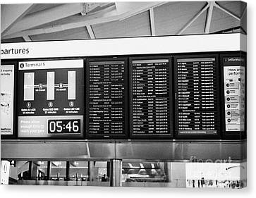 flight information boards London Heathrow Airport Terminal 5 early in the morning UK Canvas Print by Joe Fox