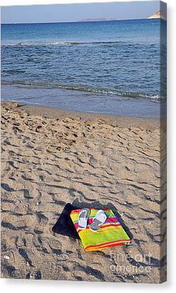 Flip Flops And Towels On Beach Canvas Print by George Atsametakis