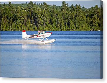 Canvas Print featuring the photograph Float Plane Landing On The Lake by Barbara West
