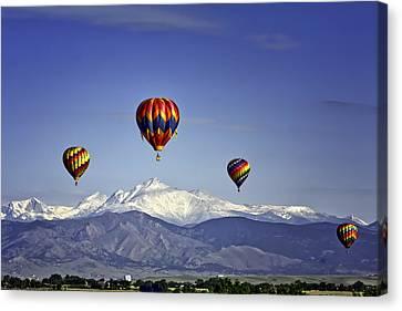 Floating Above Longs Peak Canvas Print by Teri Virbickis