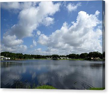 Floating Clouds Over The Lake Canvas Print by Zina Stromberg