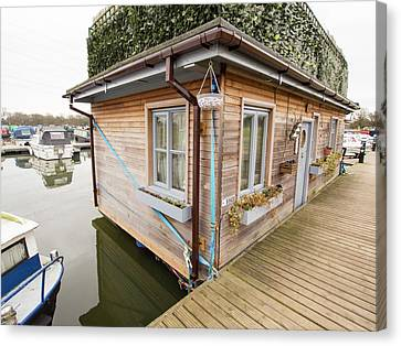Floating House Canvas Print by Ashley Cooper
