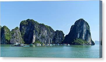 Floating Village Ha Long Bay Canvas Print by Scott Carruthers