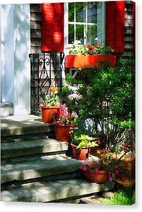 Flower Pots And Red Shutters Canvas Print by Susan Savad