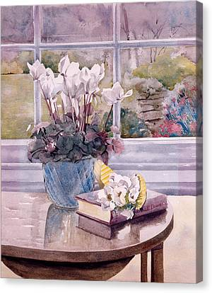 Flowers And Book On Table Canvas Print by Julia Rowntree