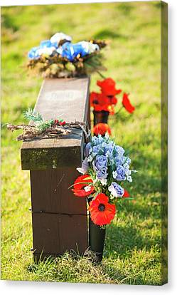 Flowers On A Memorial Bench Canvas Print by Ashley Cooper