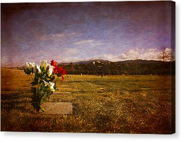 Canvas Print featuring the photograph Flowers On Memorial by Dave Garner