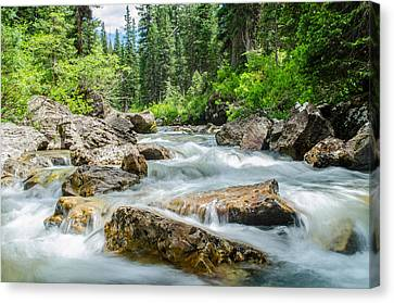 Flowing River Canvas Print by Mike Schmidt