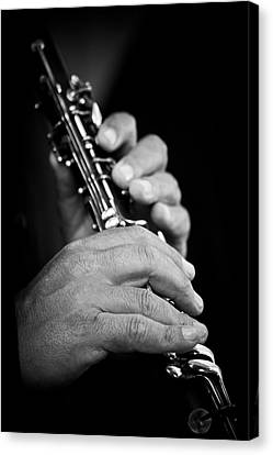 Flute Being Played In Black And White Canvas Print by Sheila Haddad