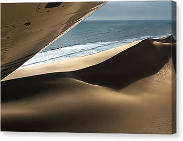 Canvas Print featuring the photograph Fly Over The Namib by Juergen Klust