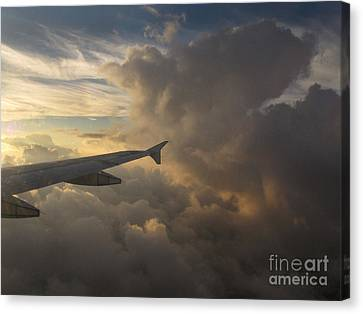 Canvas Print featuring the photograph Flying In The Clouds by Inge Riis McDonald