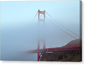 Canvas Print featuring the photograph Fog And The Golden Gate by Jonathan Nguyen