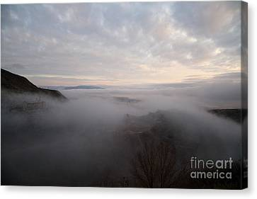 Canvas Print featuring the photograph Fog At Sunrise In Jerome Arizona With San Francisco Peaks Of Flagstaff In The Distance by Ron Chilston