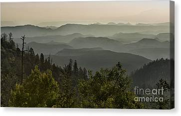 Foggy Morning Over Waterpocket Fold Canvas Print by Sandra Bronstein