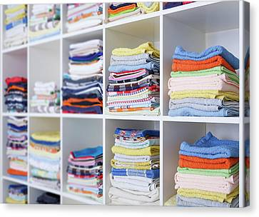 Folded Towels On Shelves Canvas Print by Wladimir Bulgar