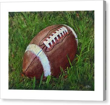 Football On Field Canvas Print by Craig Tinder