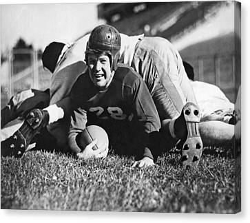 Football Player Gets Tackled Canvas Print by Underwood Archives