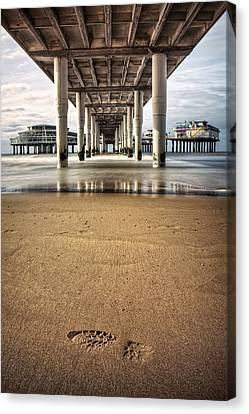 Footprints In The Sand Canvas Print by Dave Bowman