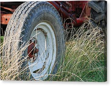 Canvas Print featuring the photograph Ford Tractor Tire by Jennifer Ancker