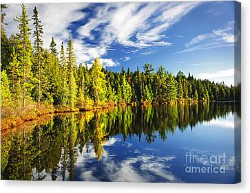 Canada Canvas Print - Forest Reflecting In Lake by Elena Elisseeva