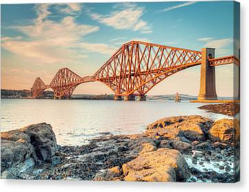 Forth Bridge At Sunset Canvas Print by Ray Devlin