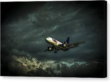 Foul Weather Fedex Canvas Print by Marvin Spates