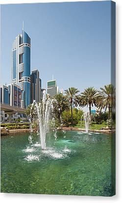 Fountain And Downtown Skyline Of Dubai Canvas Print by Michael Defreitas