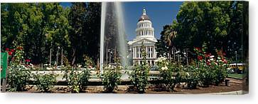 Fountain In A Garden In Front Canvas Print