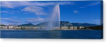 Fountain In Front Of Buildings, Jet Canvas Print