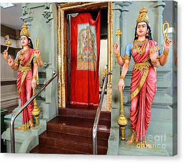 Four-armed Deities Guard The Inner Sanctum Of A Hindu Temple Canvas Print by David Hill