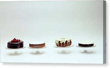 Four Cakes Side By Side Canvas Print by Romulo Yanes