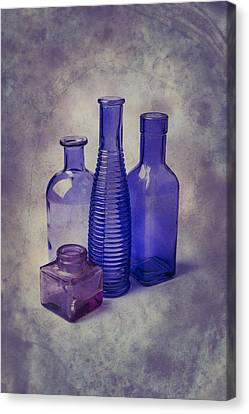 Four Glass Bottles Canvas Print by Garry Gay