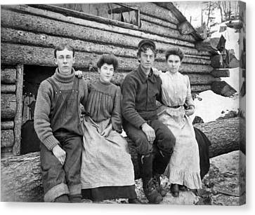 Log Cabin Canvas Print - Four Settlers In The West by Underwood Archives