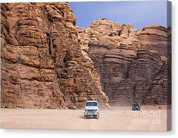 Four Wheel Drive Vehicles At Wadi Rum Jordan Canvas Print by Robert Preston