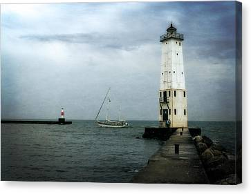 Frankfort Lighthouse With Sailboat Canvas Print by Michelle Calkins