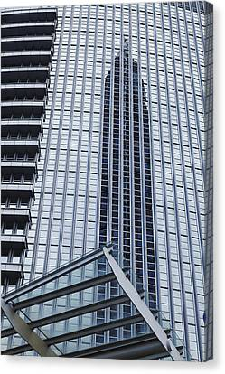 Frankfurt - Exhibition Tower Is Mirroring In A Glass Fassade Canvas Print by Olaf Schulz