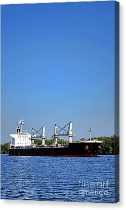 Freighter On River Canvas Print by Olivier Le Queinec