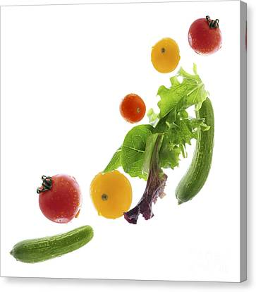 Fresh Vegetables Flying Canvas Print by Elena Elisseeva