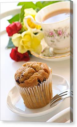 Freshly Baked Muffin With Tea Canvas Print by Amanda Elwell