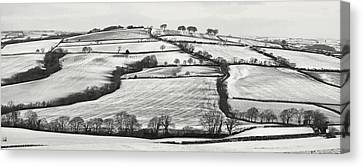 From Raddon Top In The Snow Canvas Print by Pete Hemington