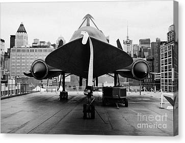 front of Lockheed A12 Blackbird on display on the flight deck at the Intrepid Sea Air Space Museum Canvas Print by Joe Fox