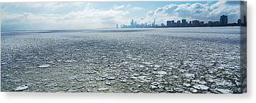 Frozen Lake With A City Canvas Print by Panoramic Images