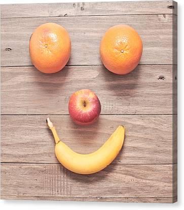 Fruit Face Canvas Print by Tom Gowanlock