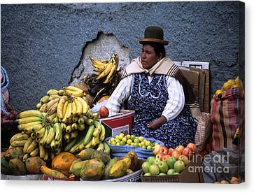 Fruit Seller Canvas Print by James Brunker