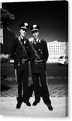 full length of Two Arma Dei Carabinieri Italian police officers on duty in Piazza Venezia Rome Lazio Canvas Print by Joe Fox
