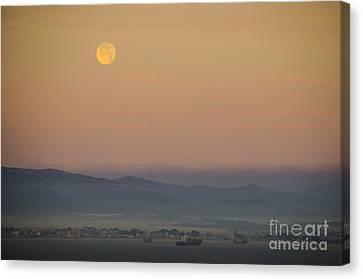 Full Moon At Sunrise Over Spanish Coast Canvas Print by Deborah Smolinske