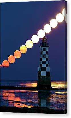 Full Moon Rising Over Lighthouse Canvas Print by Laurent Laveder
