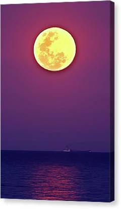 Full Moon Rising Over The Sea Canvas Print by Luis Argerich